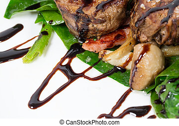 Delicious chateaubriand steak with mushrooms and spinach. Macro. Photo can be used as a whole background.