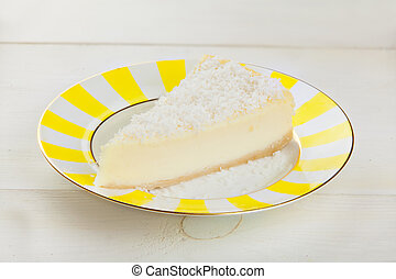 delicious cheesecake with coconut on  plate