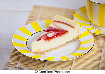 delicious cheesecake with strawberries on  plate