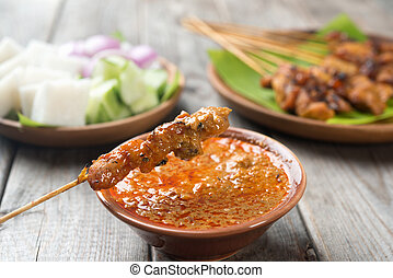 Delicious chicken satay - Malaysian chicken satay with...