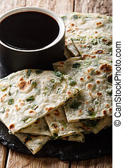 Delicious Chinese vegetarian onion pancakes served with ...