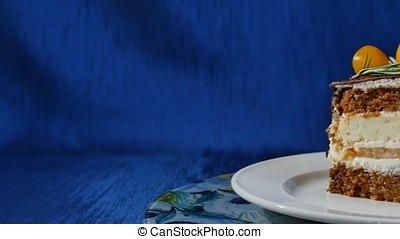 Delicious chocolate cake on plate on table on dark blue...
