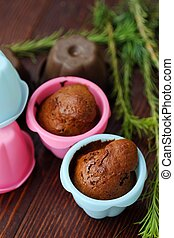 Delicious chocolate cupcakes with cinnamon on the table