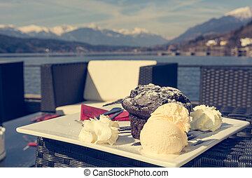 Delicious chocolate muffin served with vanilla ice cream.