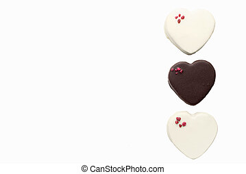 delicious chocolates with a heart shape isolated on white background with copy space