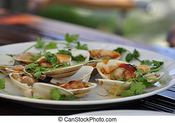 Delicious Clams - A plate of delicious clams served at the...