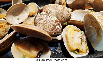 Delicious clams on hot plate