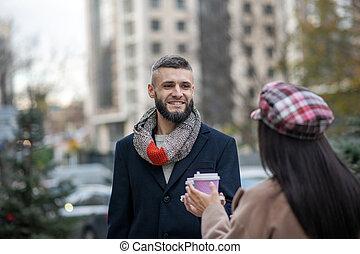 Joyful bearded man standing with his girlfriend