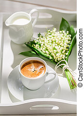 Delicious coffee with flowers