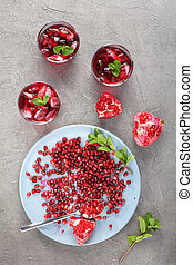 cold pomegranate juice with ice cubes