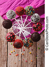 Delicious colorful cake pops in a glass. vertical top view -...