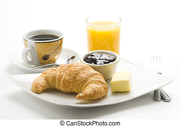 delicious continental breakfast of coffee and croissants isolated