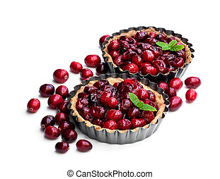 Delicious cranberry tarts in baking mold isolated on white