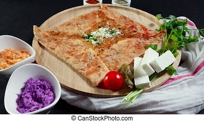 Delicious crepe with cheese served with appetizers and tea...