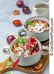 Delicious crumble of red cherry plum and oatmeal.