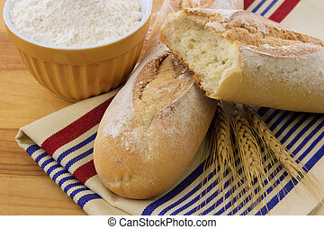 Delicious crusty baguette bread on a red white and blue...