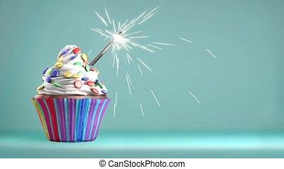 Delicious cupcake with a sparkler - Delicious cupcake with a...