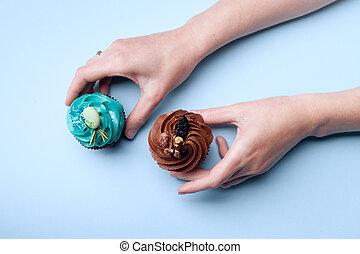delicious cupcakes in hands