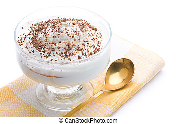 Delicious curd dessert with grated chocolate over napkin on a white background