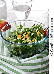 dandelion salad in a glass bowl