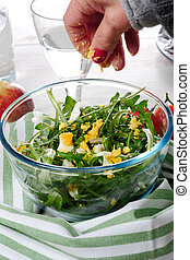dandelion salad in a glass bowl