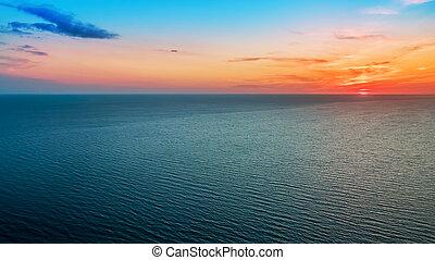 Delicious delicate sunset over a calm sea