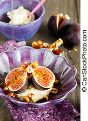 Delicious dessert with figs, honey, hazelnuts and mascarpone cheese