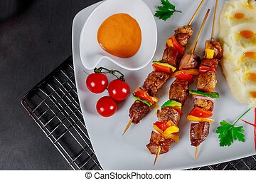 Delicious dish from grilled mixed meat skewers served with and mashed potato
