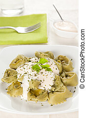 dish of tortellini with cheese sauce - delicious dish of ...