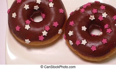 Delicious donuts with icing on plate