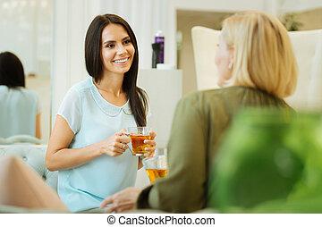 Nice young woman drinking tea
