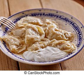 delicious dumplings with sour cream