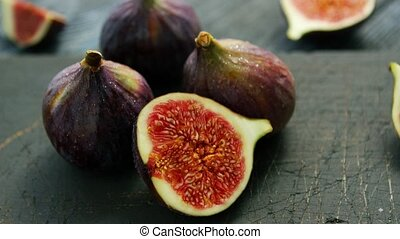 Delicious figs in closeup - Arrangement of whole and cut...