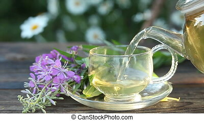 delicious  fireweed tea in a beautiful glass bowl on table