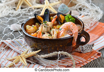 Delicious fish soup with shimps, mussels, fish fillet and ...