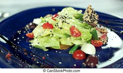 Delicious French salad. Lettuce, quail egg and tuna.
