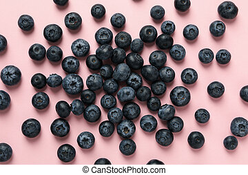 Delicious fresh blueberry on pink background, top view