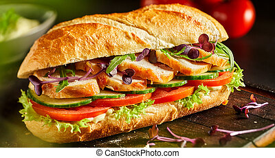 Delicious fresh chicken baguette with salad
