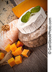 Delicious fresh french cheeses served on wooden table