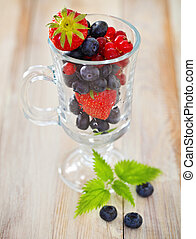 Delicious fresh fruits in the glass cup