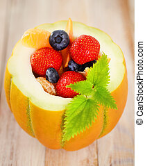 Delicious fresh fruits served in melon as dessert