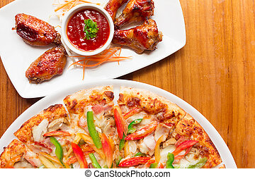 Delicious fresh pizza served Chicken Wings on wood background
