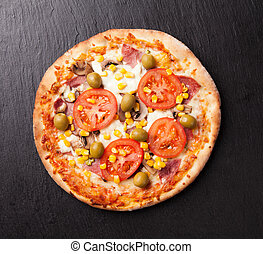 Delicious fresh pizza served on black stone