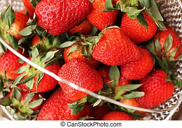 Delicious fresh strawberries on a wooden table