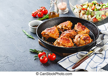 Delicious fried chicken thighs in a cast iron skillet - ...