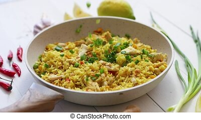 Delicious fried rice with chicken and vegetables served in ...