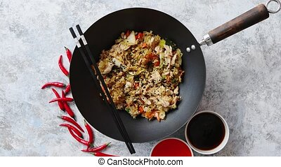 Delicious fried rice with chicken in wok - Delicious fried...