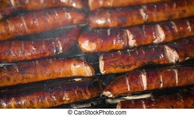Delicious fried sausages on home barbecue. Close up shot.