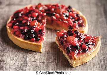 delicious fruit tart dessert on wooden background