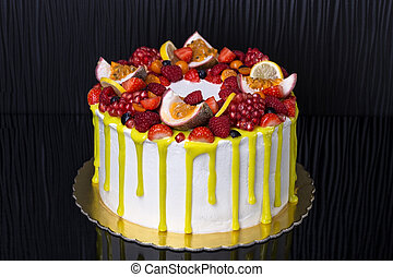 Delicious fruit yellow cake, for birthday. On dark background.